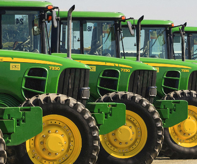 Large agricultural harvest and higher commodity prices continue to boost tractors and harvesters' sales